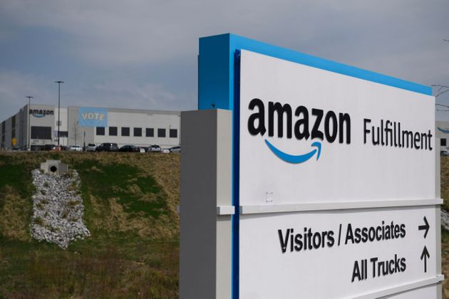 Vote signage hangs outside the Amazon.com, Inc. fulfillment center in Bessemer, Alabama on March 26,...