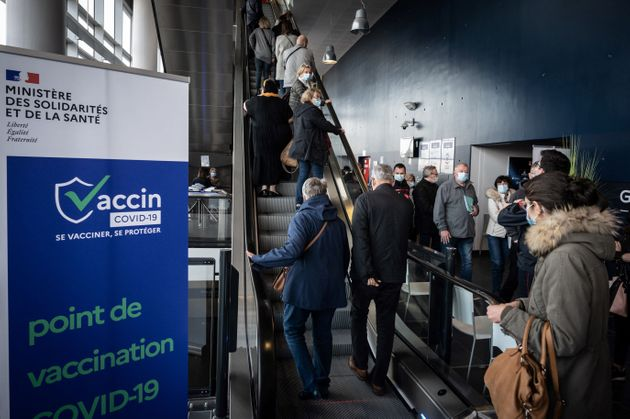 People arrive to be vaccinated against Covid-19 on the opening day of a mass vaccination centre set up...