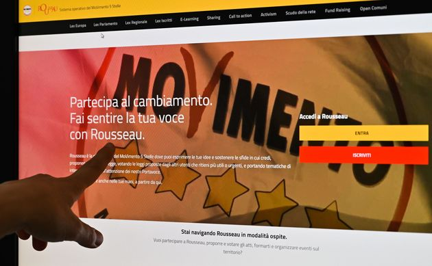 A user points to the gateway of Italian M5S Five Star political movement's online e-voting platform