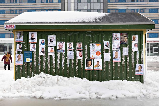 Campaign Posters for Greenland's legislative elections hang on a bus shed in the center of Nuuk, April...