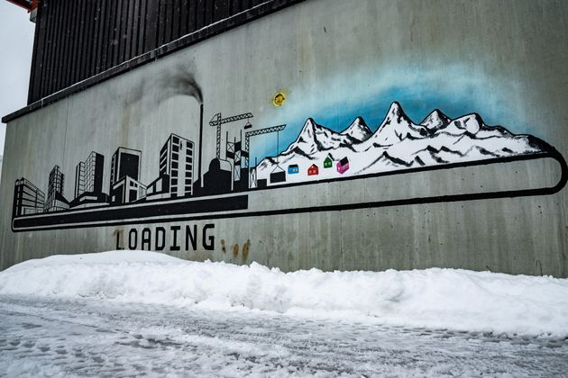 Wall painting with modern times vs traditional way of life is seen in Nuuk, Greenland April 2, 2021....