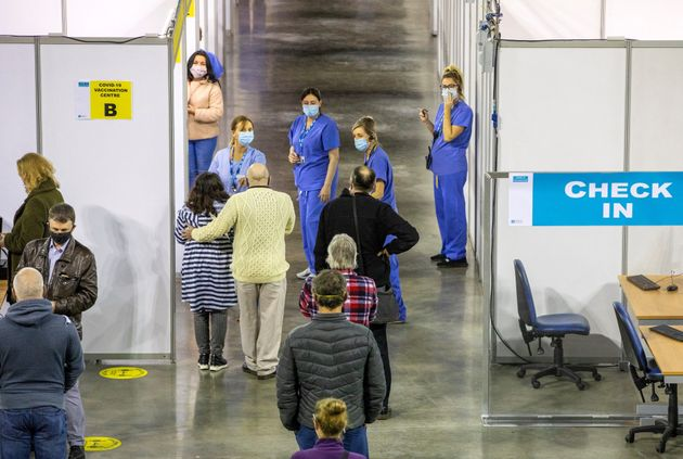 members of the public wait to receive a dose of the AstraZeneca/Oxford Covid-19 vaccine at the SSE Arena...