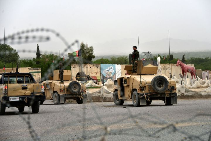 Afghan security forces stand onHumvees during a military operation in the Arghandab district of Kandahar province on Ap