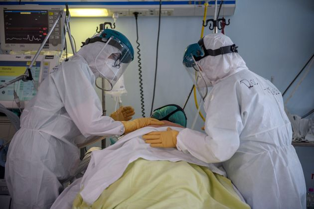 ROME, ITALY - MARCH 20: Healthcare workers in personal protective equipment (PPE) treat Covid-19 patients...