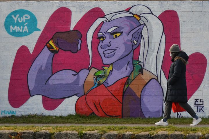 A woman walks by the mural of Huntara from Netflix's 'She-Ra and the Princesses of Power' in Dublin's Grand Canal area painted by Irish artist Emmalene Blake for International Women's Day.  On Monday, 8 March, 2021, in Dublin, Ireland. (Photo by Artur Widak/NurPhoto via Getty Images)