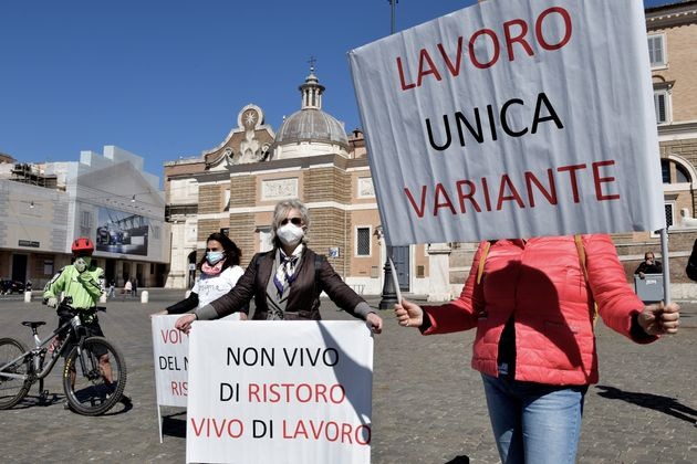 ROME, ITALY - APRIL 08: People participate in the demonstration in Piazza del Popolo to demand economic...
