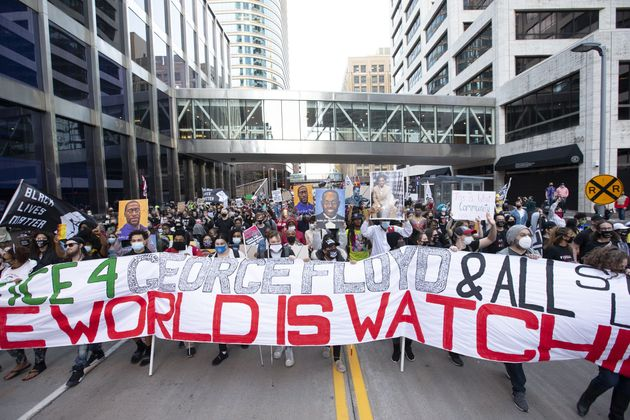 MINNESOTA, USA - MARCH 29: Protesters march down a street in Minneapolis as they protest and demand justice...