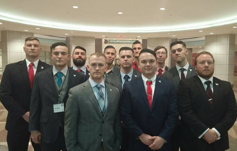 Shawn McCaffrey, in the front row wearing a red tie, poses for a photo with fellow members of the white nationalist group Ide