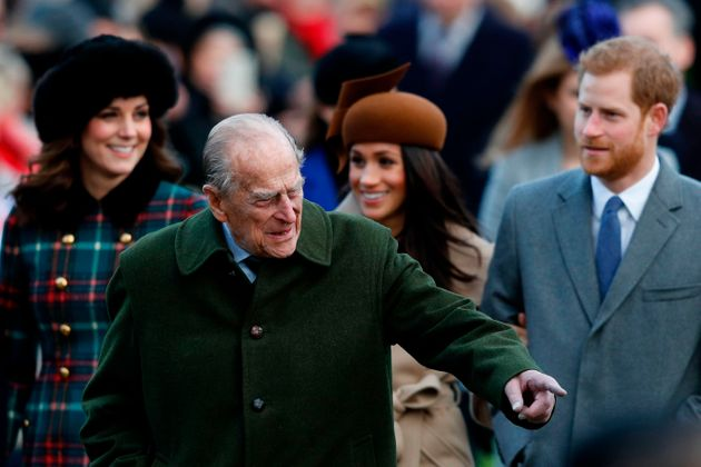 Britain's Prince Philip, Duke of Edinburgh (C) gestures as he is followed by (L-R) Britain's Catherine,...