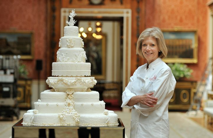Fiona Cairns stands next to the wedding cake she and her team made for Prince William and Kate Middleton.