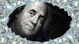 large group of money and Benjamin Franklin portrait from one hundred dollar bill