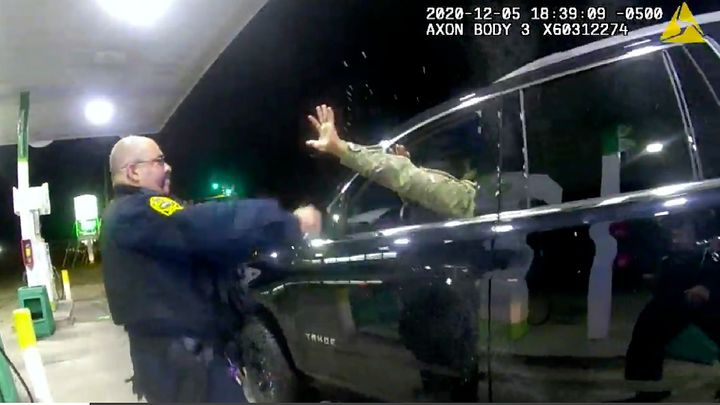 In this image made from Windsor, (Va.) Police video, a police officer uses a spray agent on Caron Nazario on Dec. 20, 2020, i