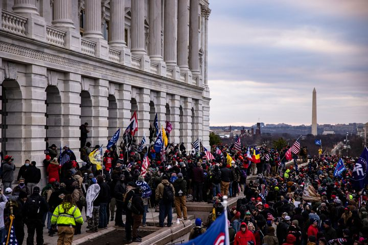 WASHINGTON, DC - JANUARY 06: A pro-Trump mob storms the U.S. Capitol following a rally with President Donald Trump on January