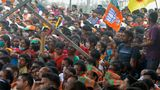 Supporters of Bharatiya Janata Party (BJP) attend a public rally being addressed by Indian Prime Minister Narendra Modi (not pictured) during the ongoing fourth phase of the West Bengal's state legislative assembly elections, at Kawakhali on the outskirts of Siliguri on April 10, 2021. (Photo by Diptendu DUTTA / AFP) (Photo by DIPTENDU DUTTA/AFP via Getty Images)