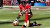 In this 2010 file photo, Philip Adams, then a cornerback for the San Francisco 49es, can be seen kneeling on the field at Candlestick Park in San Francisco.