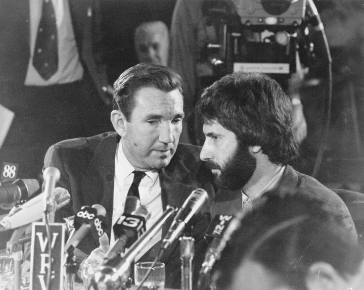 New York City police officer Frank Serpico sits with his attorney, former US Attorney General Ramsey Clark, during a press co