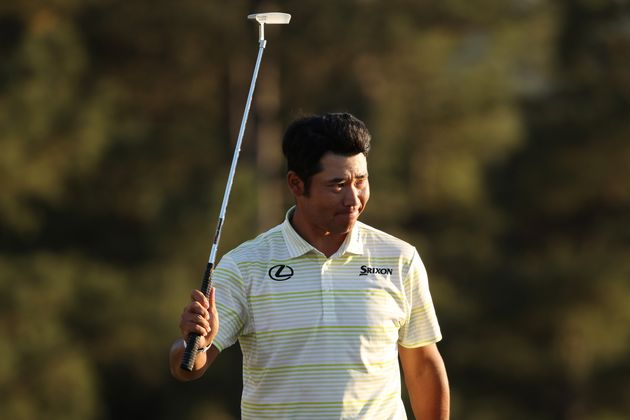 AUGUSTA, GEORGIA - APRIL 11: Hideki Matsuyama of Japan celebrates on the 18th green after winning the...