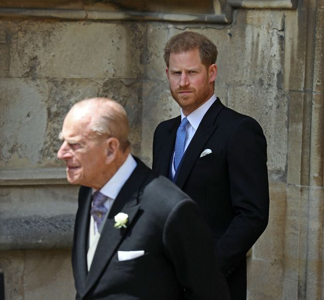 WINDSOR, ENGLAND - MAY 18: Prince Philip, Duke of Edinburgh and Prince Harry, Duke of Sussex leave after...