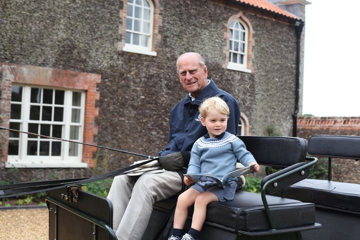 The Duke of Edinburgh and his great-grandson, Prince George, at Norfolk in 2015.