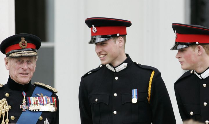 Prince Philip talks with his grandsons Prince William and Prince Harry at the Sovereign's Parade at Sandhurst Military Academ