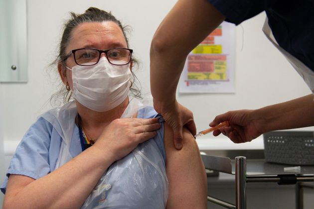 A nurse is given the Oxford/AstraZeneca Covid-19 vaccine in Coventry on January