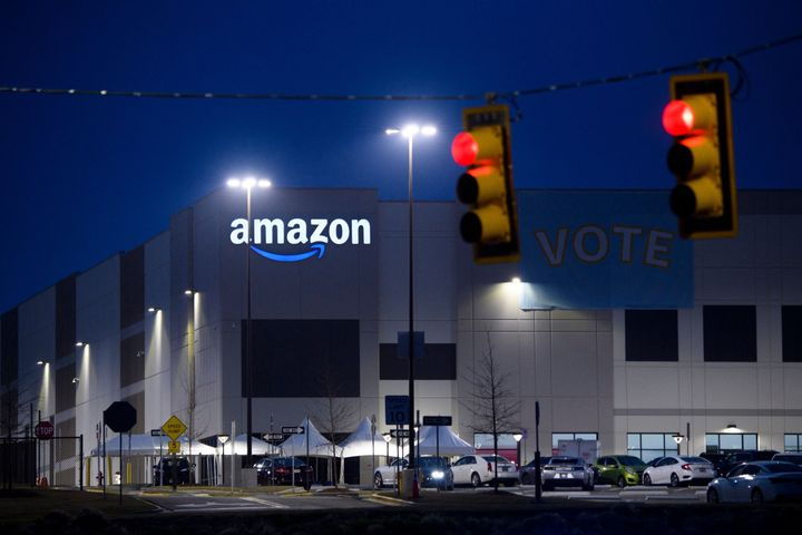 """A """"Vote"""" banner hangs at Amazon's Bessemer, Alabama, warehouse during the union election. Workers ended up voting 1,798 to 738 against unionizing."""