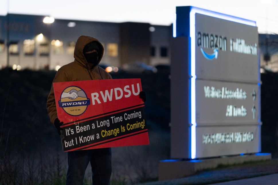 "Amazon had anti-union messaging throughout the warehouse and put workers through so-called ""captive audience"" meetings, where"