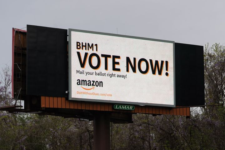 Amazon urged workers to cast their ballots as quickly as possible, even having a billboard put up on the interstate.