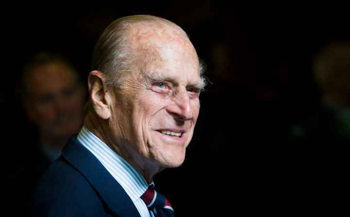 Prince Philip smiles during a visit to the headquarters of the Royal Auxiliary Air Force's 603 Squadron on July 4, 2015, in E