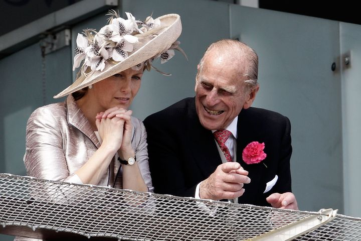 The Duke of Edinburgh (right) and Countess of Wessex wait for the start of the Epsom Derby on June 4, 2011, in Epsom, England