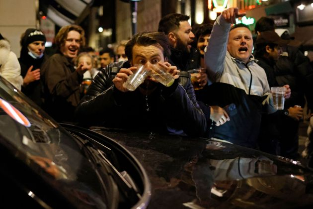 'Like VE Day' – Crowds Gather In London's Soho To Celebrate Pubs