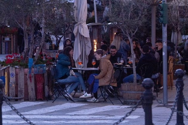 OLBIA, ITALY - MARCH 20: Customers sit outside a bar in Olbia where bars, together with the restaurants...