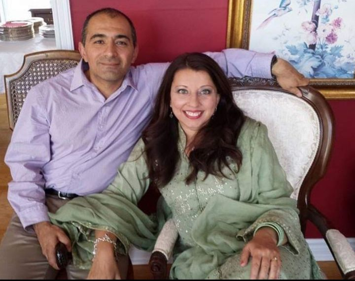 Ausma Khan, an author based in Denver, with her husband during a pre-pandemic Eid, an Islamic holiday after the month of Rama
