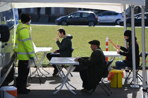 <strong>People take Covid-19 tests at a mobile coronavirus surge testing centre in south London.</strong>