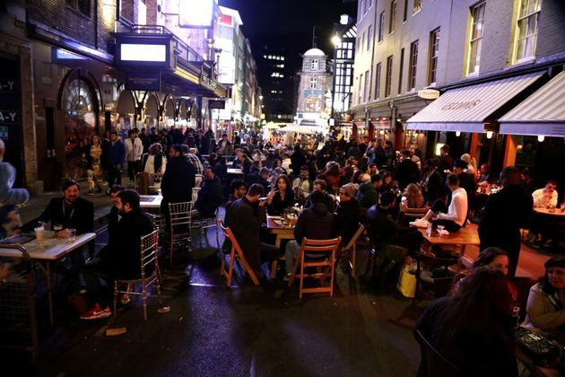 LONDON, UNITED KINGDOM - APRIL 12: People crowd the Soho area after restaurants and pubs, which were...
