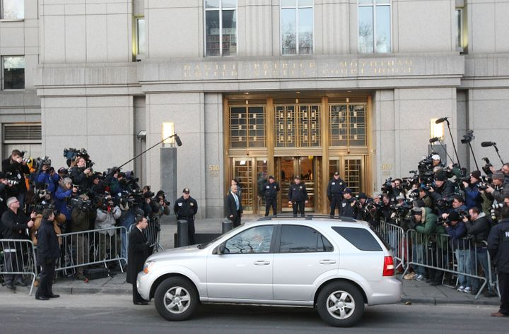 Madoff's vehicle is seen surrounded by members of the press as he arrives atthe Manhattan Federal court on March 12, 20