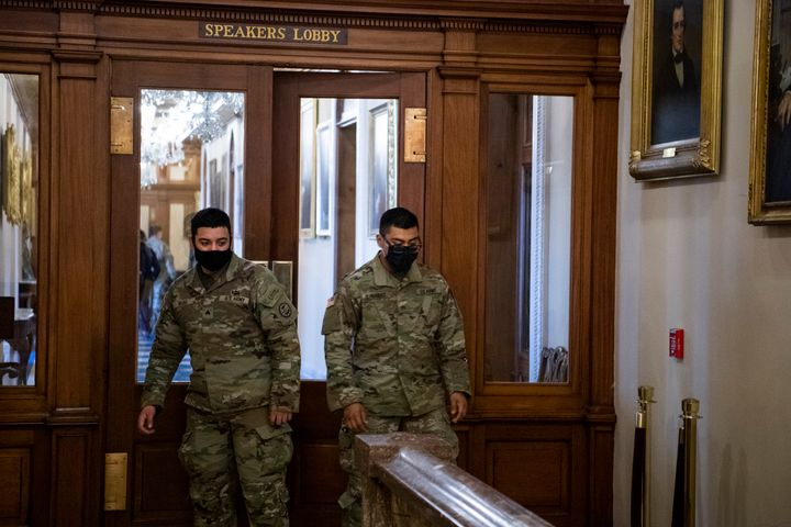 Members of the National Guard are seen in the Speakers Lobby at the door where Ashli Babbitt was killed during the Capitol ri