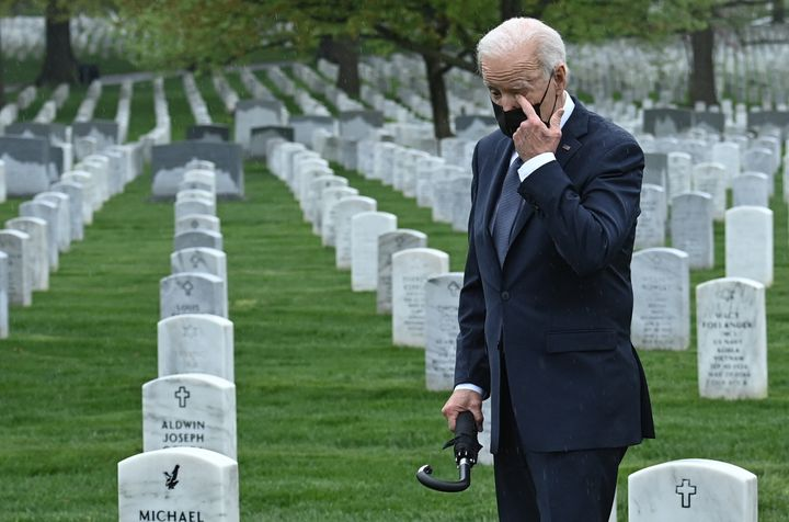 President Joe Biden wipes his eye as he walks through Arlington National Cemetery in Virginia on Wednesday.