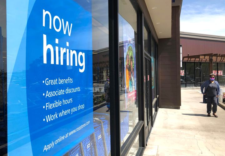 A pedestrian walks by a now hiring sign at Ross Dress For Less store on April 02, 2021, in San Rafael, California.The L