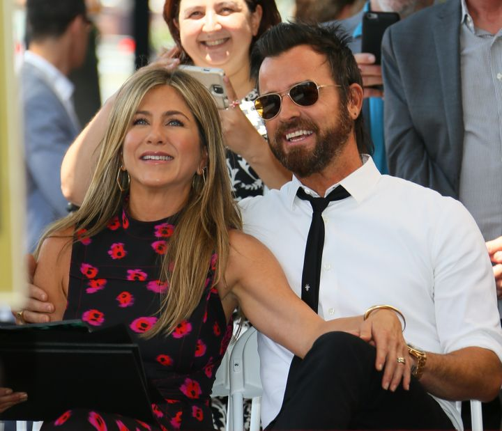 Jennifer Aniston and Justin Theroux attend the ceremony honoring Jason Bateman with a star on the Hollywood Walk of Fame in 2