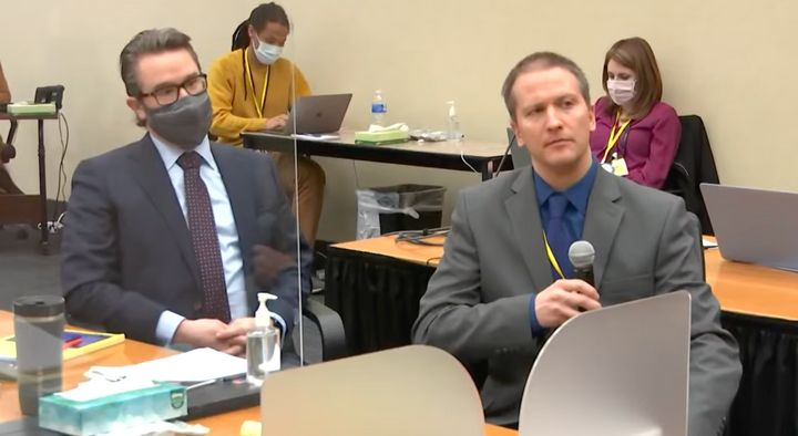 Defense attorney Eric Nelson (left) looks on as Derek Chauvin (right) tells Judge Peter Cahill on Thursday that he is invokin