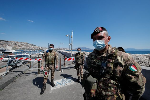 NAPLES, CAMPANIA, ITALY - 2021/04/05: Italian Army soldiers are at a checkpoint on the sea front in Naples...