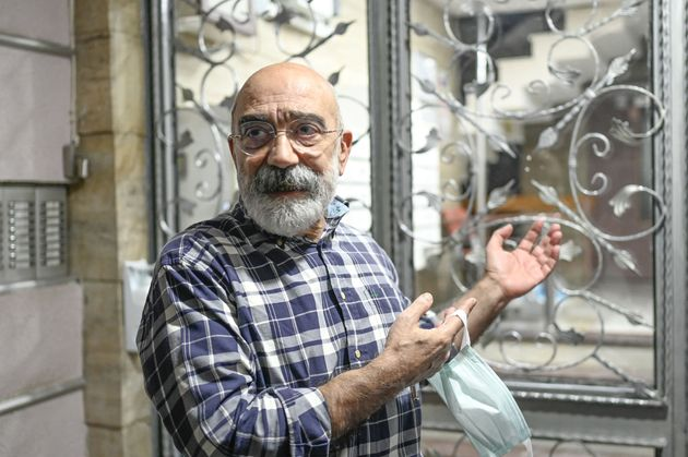 Turkish journalist and writer Ahmet Altan poses for AFP at his home minutes after he arrived following...