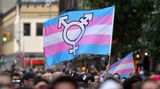 A person holds a transgender pride flag as people gather on Christopher Street outside the Stonewall Inn for a rally to mark the 50th anniversary of the Stonewall Riots in New York, June 28, 2019. - The June 1969 riots, sparked by repeated police raids on the Stonewall Inn -- a well-known gay bar in New York's Greenwich Village -- proved to be a turning point in the LGBTQ community's struggle for civil rights. (Photo by ANGELA WEISS / AFP)        (Photo credit should read ANGELA WEISS/AFP via Getty Images)