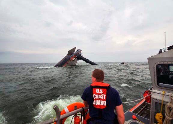 In this photo provided by the U.S. Coast Guard, A Coast Guard Station Grand Isle 45-foot Response Boat-medium boat crew membe