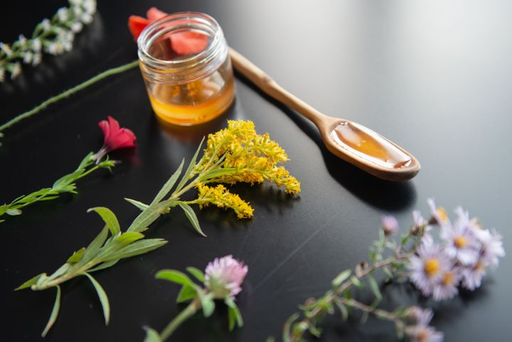 Studies haven't shown there to be enough pollen in honey to effectively ward off allergies.
