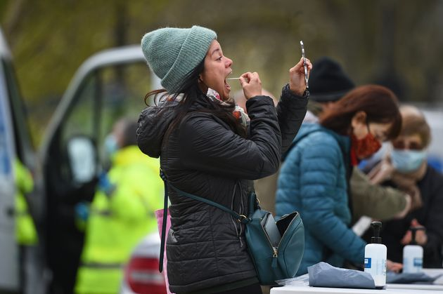 People take part in coronavirus surge testing on Clapham Common, south