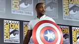 Anthony Mackie, who plays Falcon, carries Captain America's shield at the San Diego Comic-Con International 2019 Marvel Studios Panel.