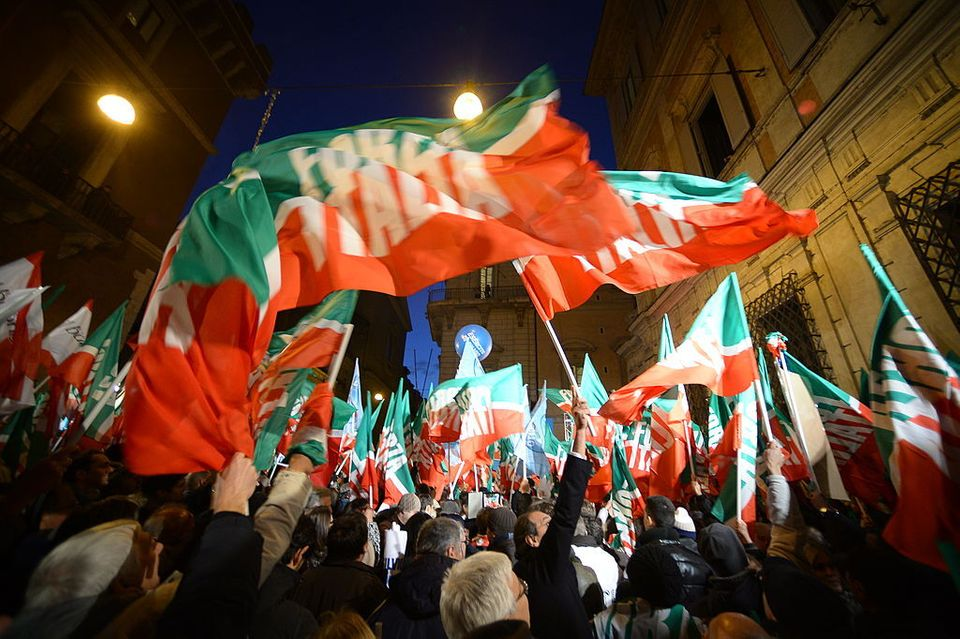 Supporters of Italy's former Prime Minister Silvio Berlusconi gather outside his private residence, the...