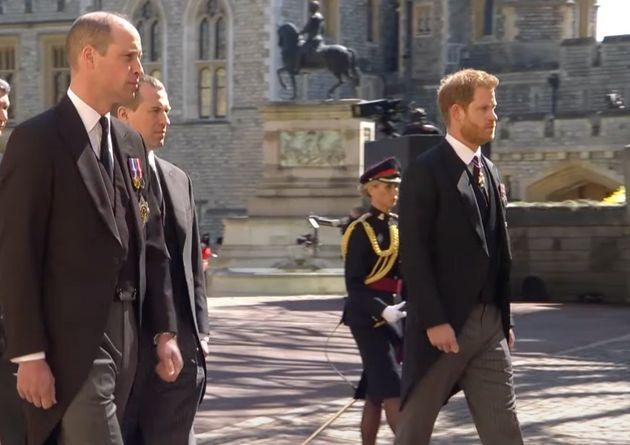Prince William, left, walks in the funeral procession near Prince Harry, right.